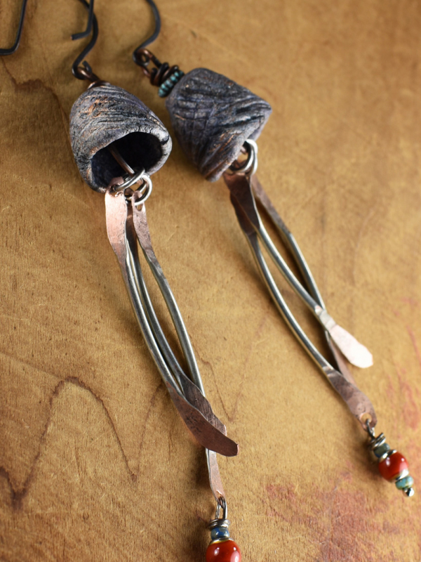 Hammered dangle and mood bead earrings by Gloria Ewing.