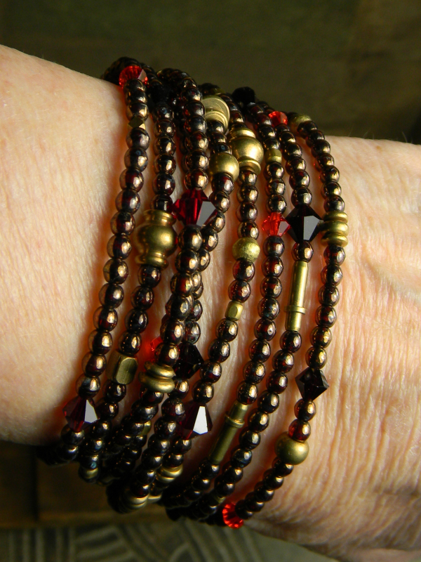 Bohemian multi-strand bracelet design in garnet and red.