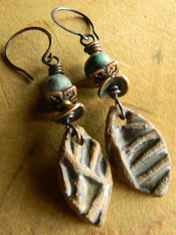 Primitive ceramic shards with copper by Gloria Ewing.