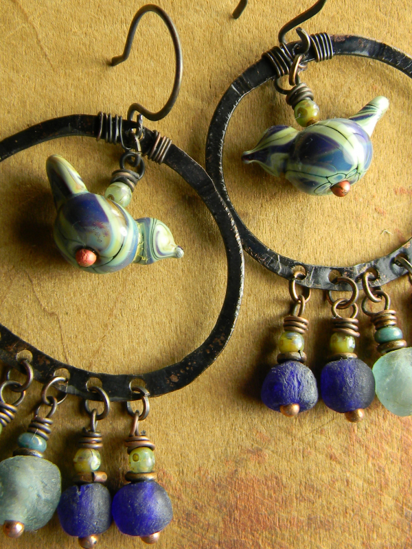 Lampwork bird and recycled glass earrings by Gloria Ewing.
