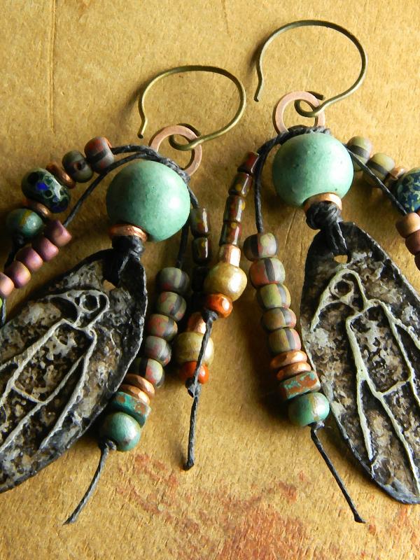 Artisan beaded earrings in a primitive style by Gloria Ewing.