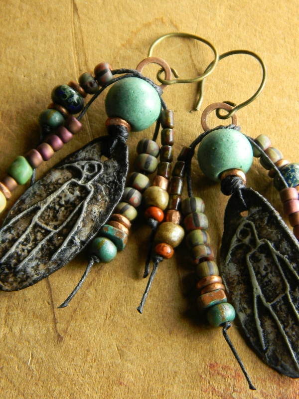 Ancient looking cave drawing earrings.