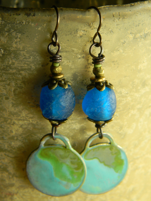 Blue and green beaded brass earrings by Gloria Ewing.