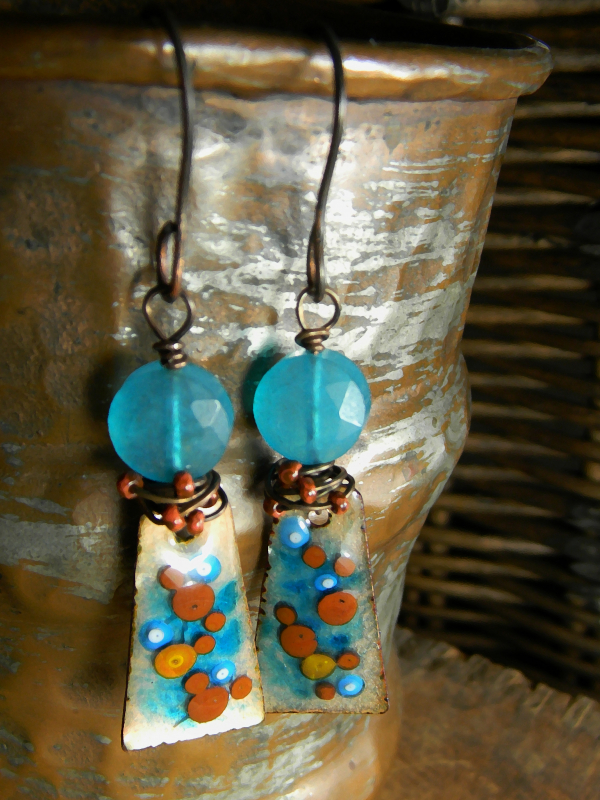 Blue jade coin beads with brilliant blue copper enamel in a wire wrapped earring