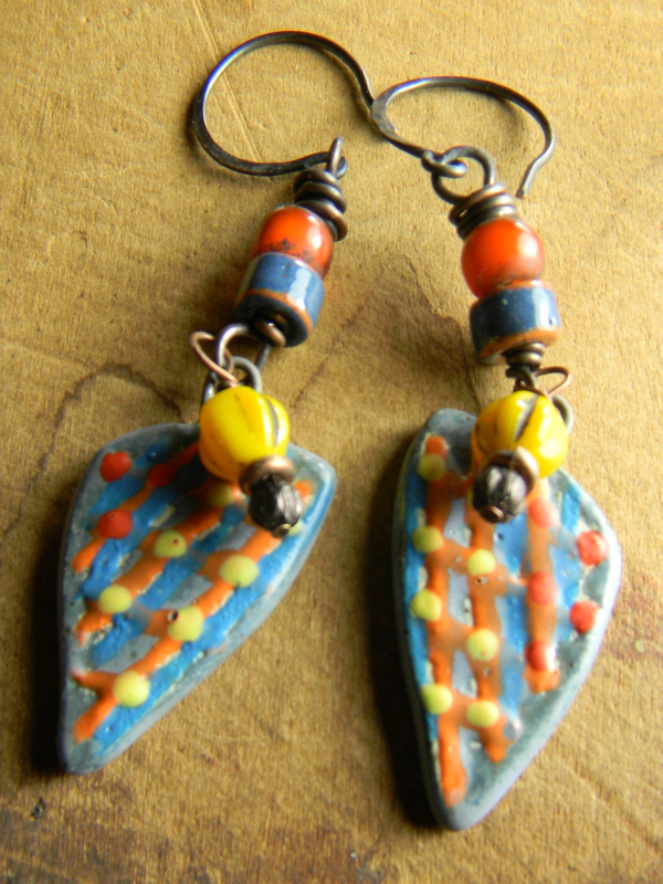 Blue, orange and yellow beaded design by Gloria Ewing.