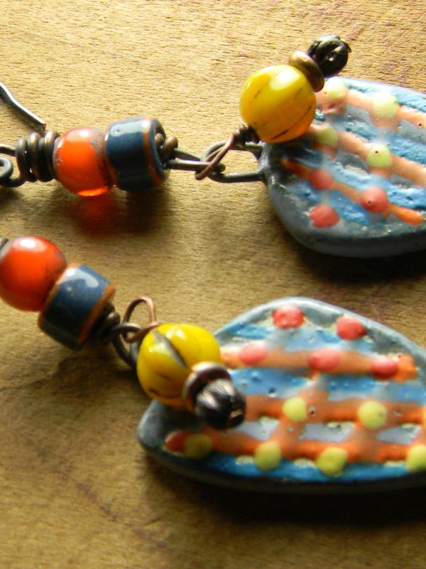 Asymmetrical shard earrings with colorful beads by Gloria Ewing.