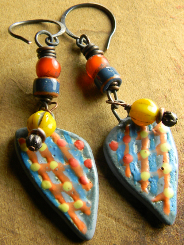 Ethnic style beaded earrings with orange white hearts by Gloria Ewing.