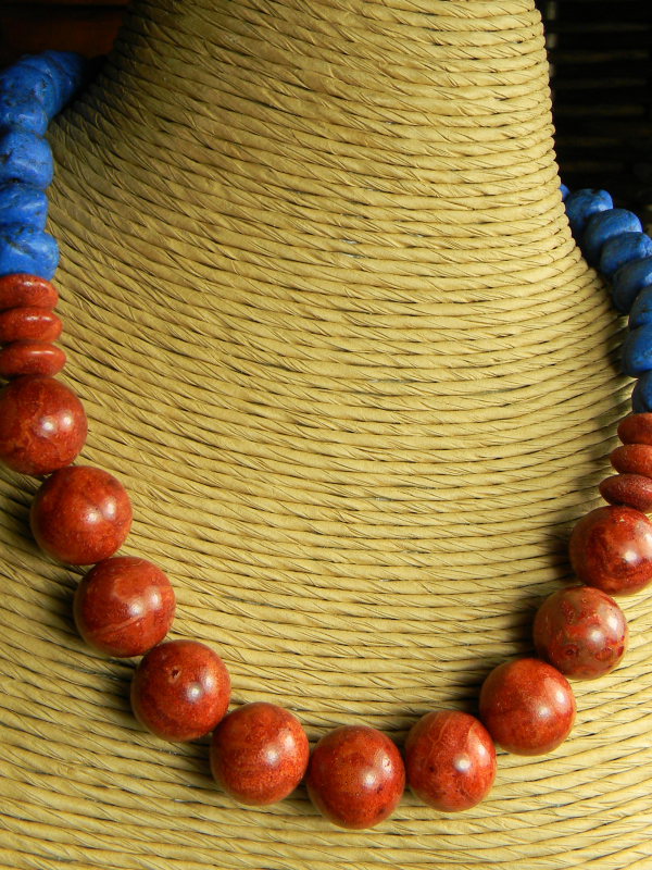 Red sponge coral beaded choker necklace by Gloria Ewing.