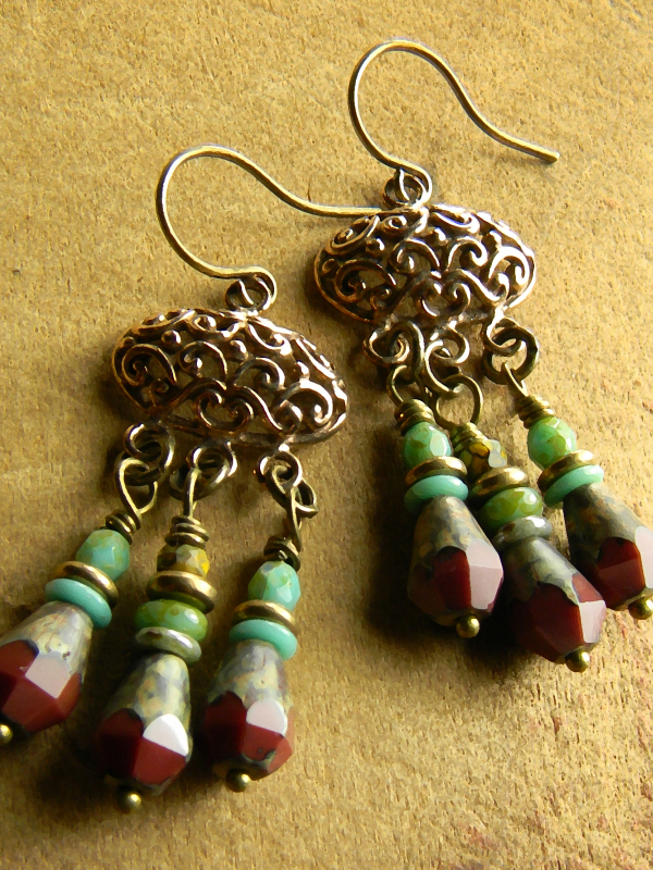 Bronze and red with touches of blue, beaded earrings by Gloria Ewing.