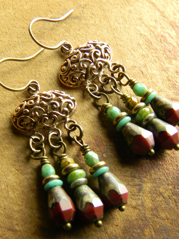 Dark red and blue with bronze in beaded earrings by Gloria Ewing.