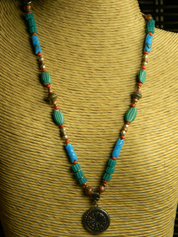 Amulet with colorful trade beads by Gloria Ewing.
