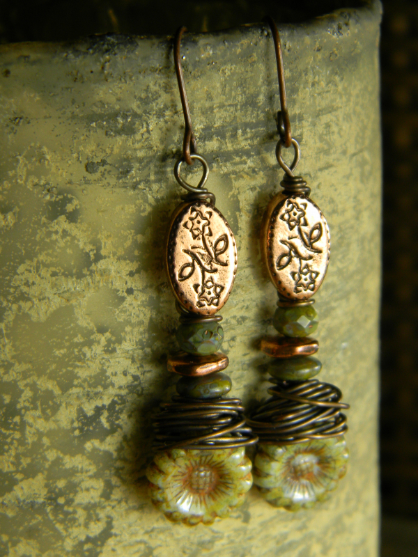 Wire wrapped copper earrings by Gloria Ewing.