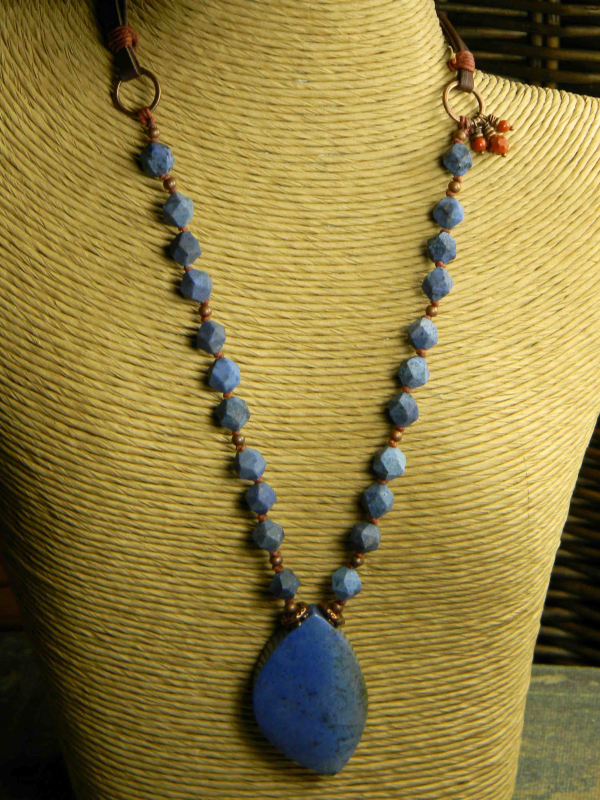 A beaded pendant necklace perfect for wear with blue jeans.