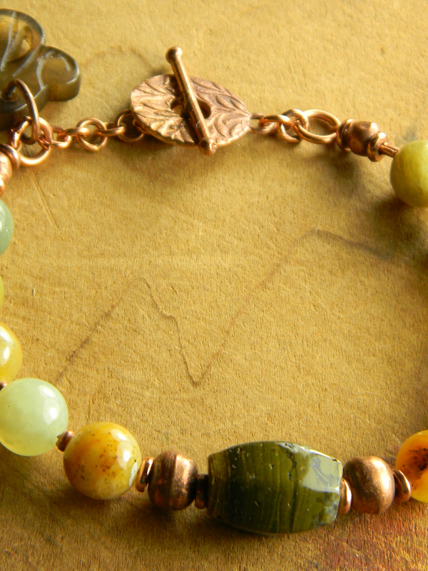 Beautiful greens with copper in this bracelet by Gloria Ewing.