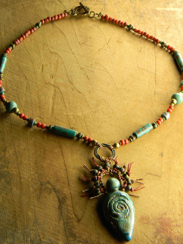 Tribal trade bead necklace with brass by Gloria Ewing.