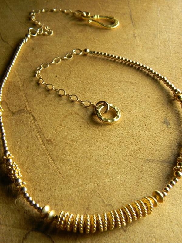 Boho style beaded gold choker necklace by Gloria Ewing.