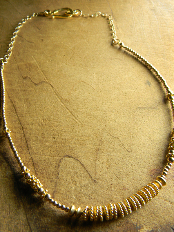 Mix of gold filled and gold vermeil beads by Gloria Ewing.