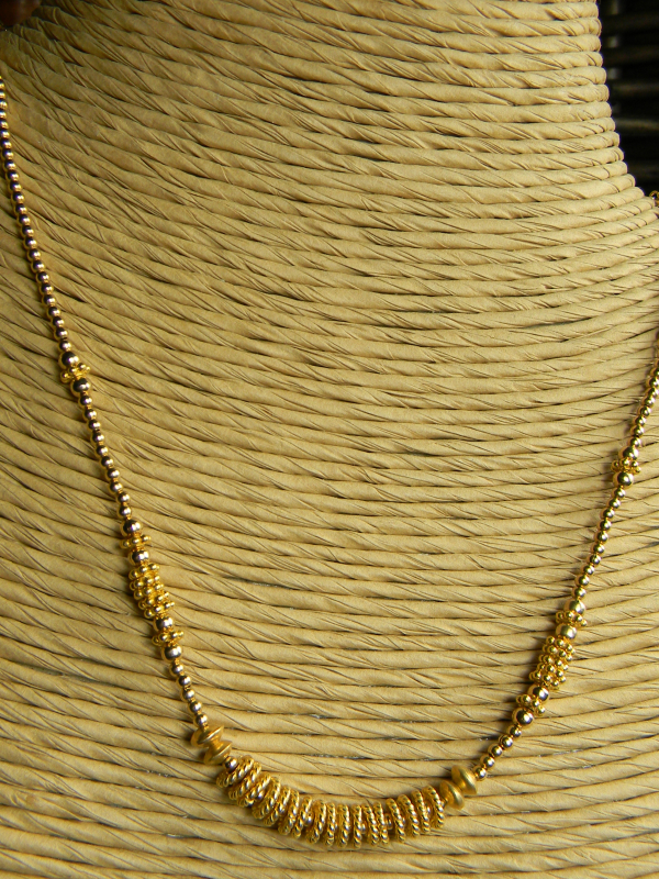 Gold filled and gold vermeil beaded necklace by Gloria Ewing.
