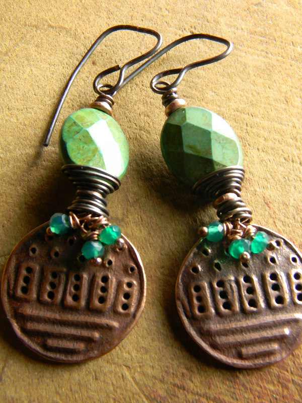 Rustic copper wire wrap, and faceted green stones by Gloria Ewing.