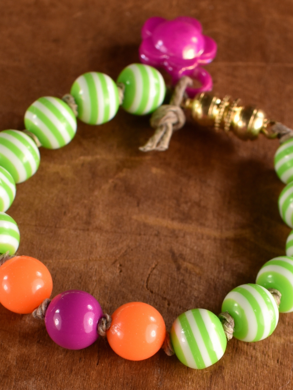 Brightly colored acrylic beaded child's bracelet by Gloria Ewing.