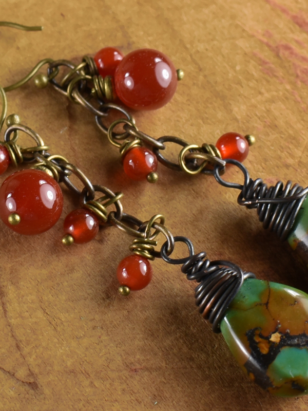 Dangling carnelian over turquoise drops by Gloria Ewing.