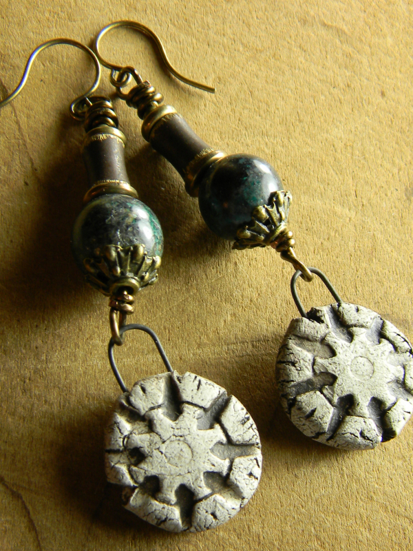Rustic brass with artisan ceramic drops and chrysocolla.