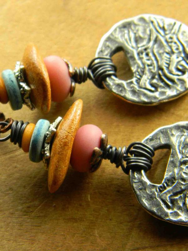 Native horse motif in beaded earrings by Gloria Ewing.