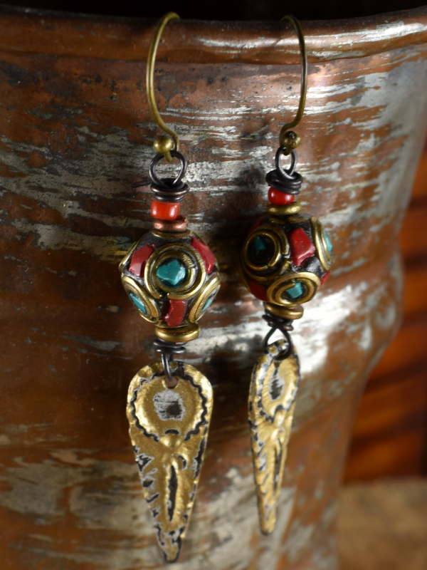 Inlaid beads and artisan charms in an earring design by Gloria Ewing.