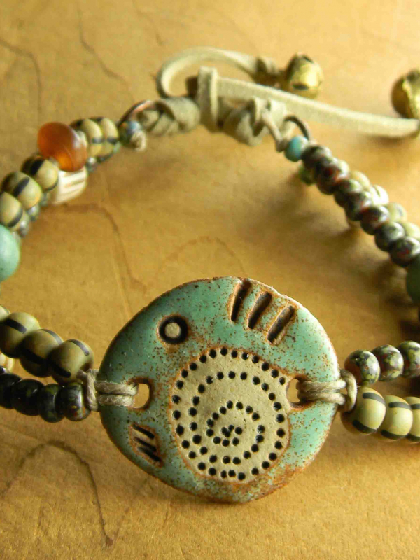 Striped beads and primitive focal together by Gloria Ewing.