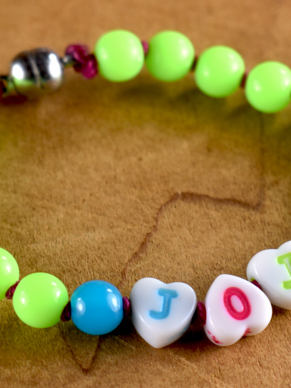 Easy to wear acrylic beaded bracelet with name by Gloria Ewing.