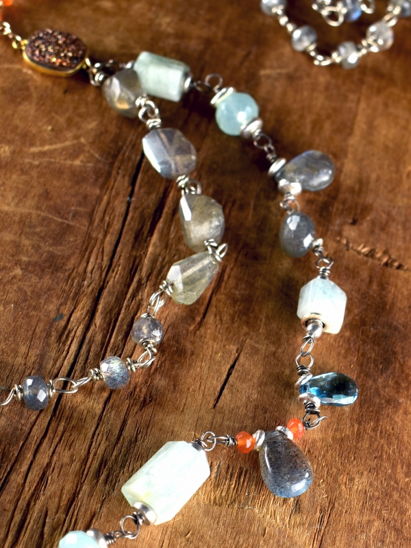 Labradorite and varied gems linked in silver and gold by Gloria Ewing.