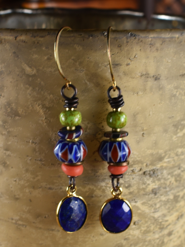 Lapis Lazuli and chevron beads in drop earrings by Gloria Ewing.