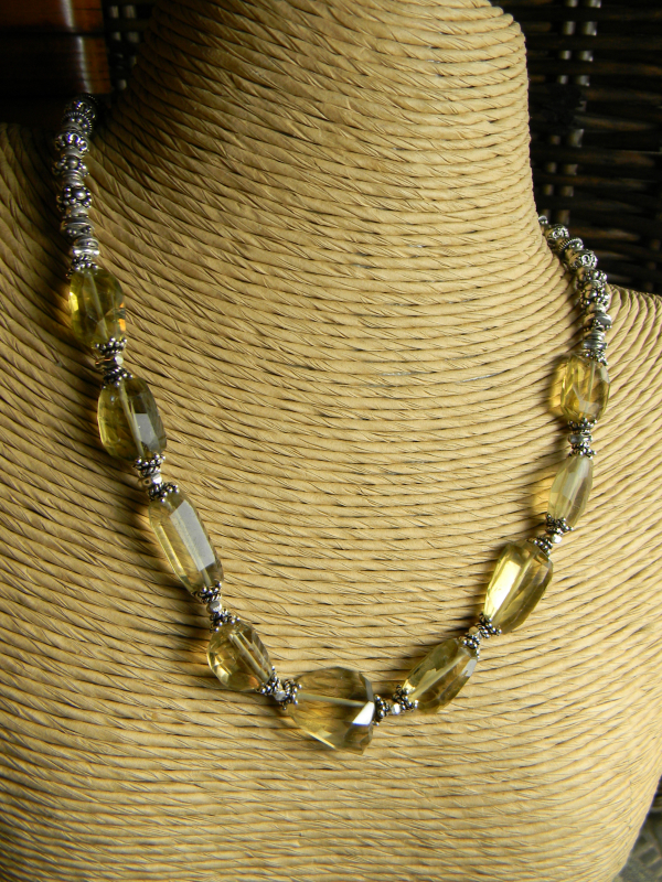 Chunky lemon quartz faceted nuggets in this unusual choker by Gloria Ewing.