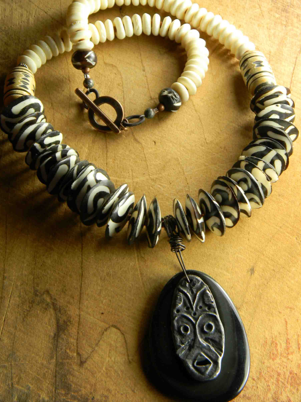 Dramatic bone and shell beaded necklace by Gloria Ewing.