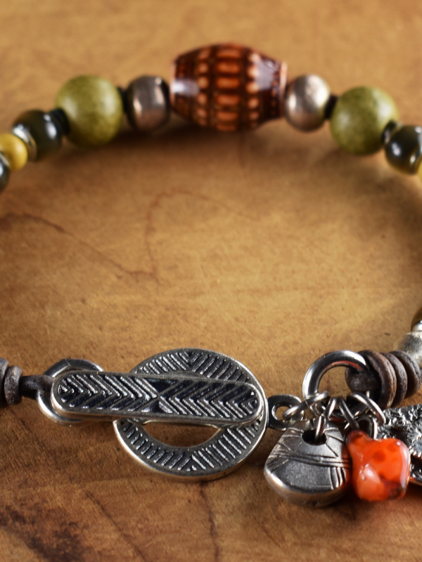 Mood beads with pewter accents in a tribal design by Gloria Ewing.