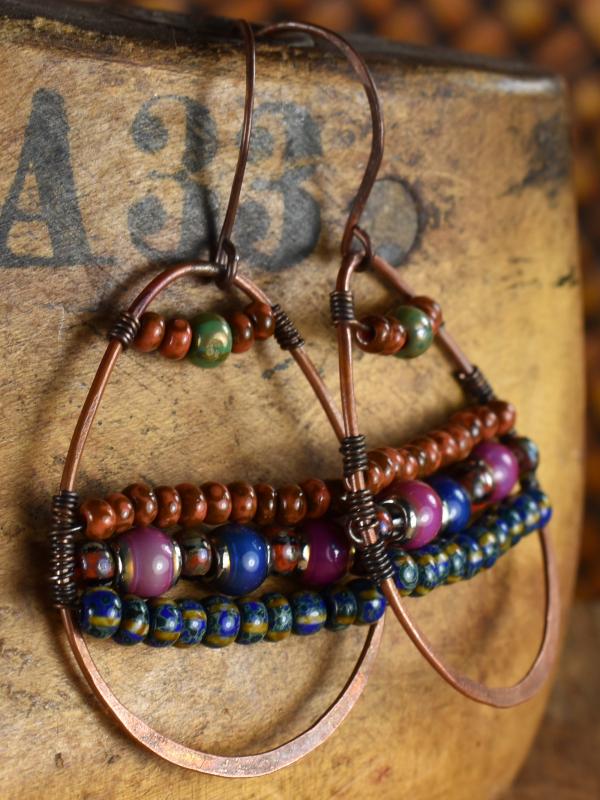 Richly colored bead woven hoop earrings by Gloria Ewing.