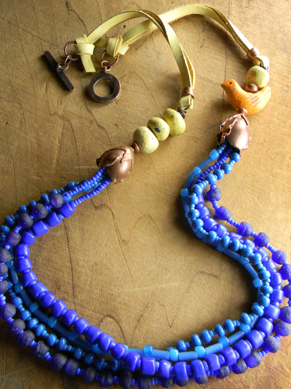 Blue Multi necklace with leather, clay & copper by Gloria Ewing.