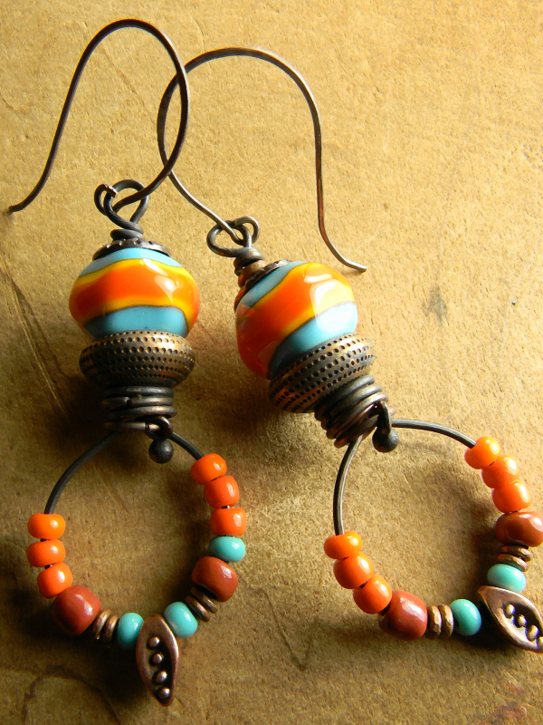 Wildly colorful Tejana Collection Hoop earrings by Gloria Ewing.