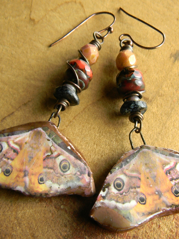 Moth drop focal earrings with pink and bronze by Gloria Ewing.