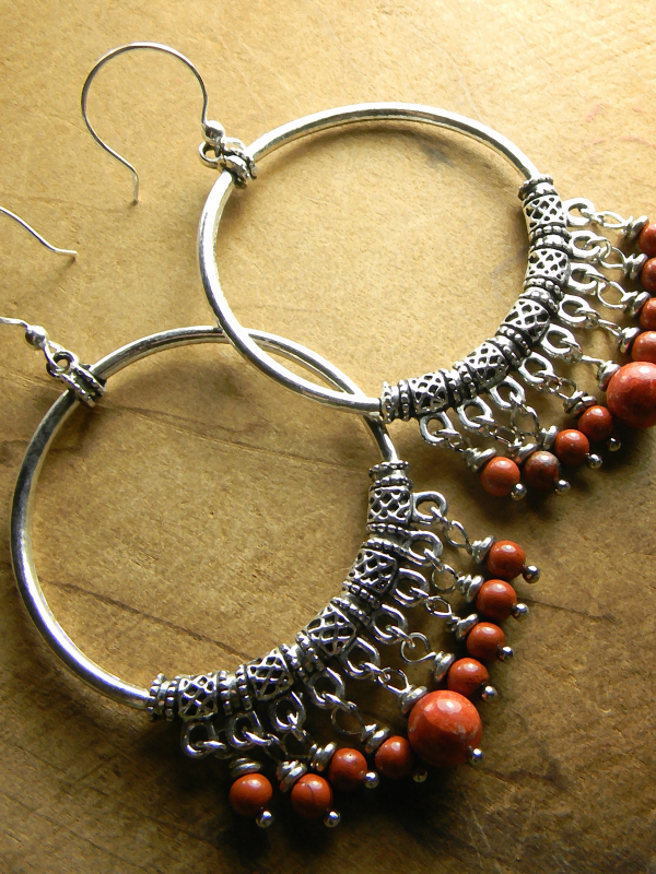 Silver with red sponge coral earrings by Gloria Ewing.