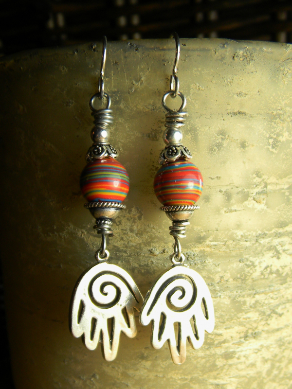 Tejana Collection Spiral Hand earrings by Gloria Ewing.