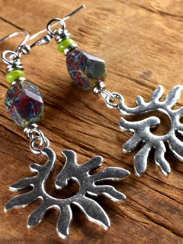 Beaded sun charms with a tribal flair by Gloria Ewing.