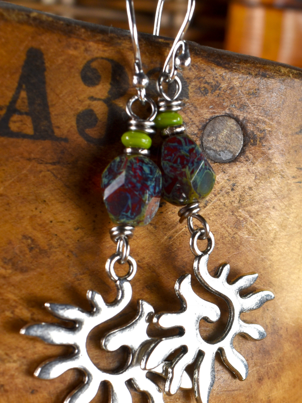 Pewter spiral sun charms with Czech glass by Gloria Ewing.