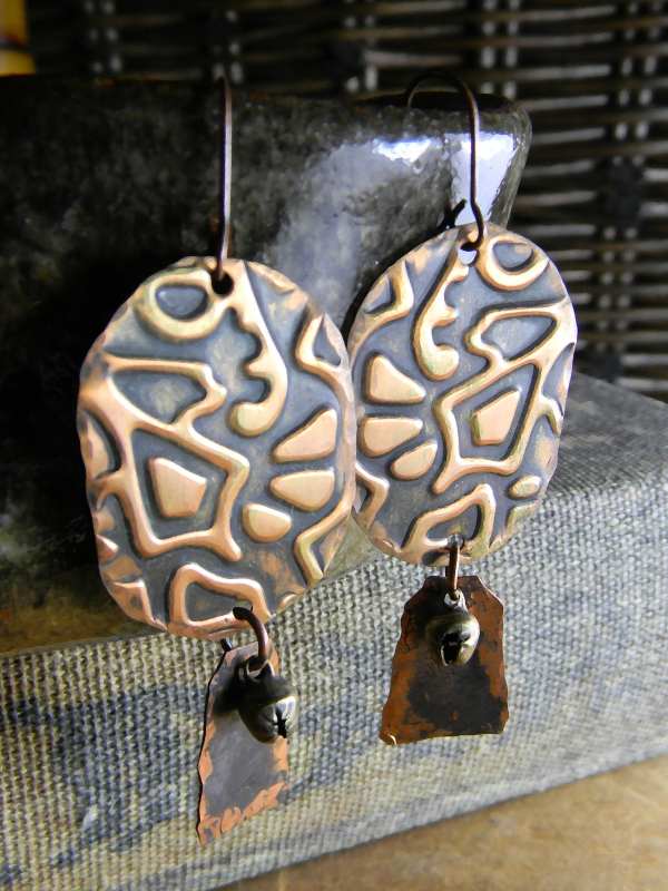 Rustic time worn copper earrings with primitive texture.