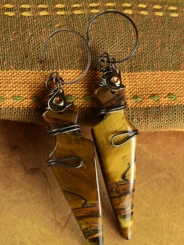 Arrowhead shaped tiger eye with wire wrap by Gloria Ewing.