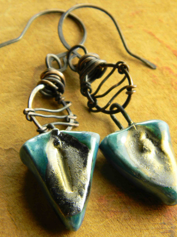 Artisan ceramic drops with a wire wrap design by Gloria Ewing.