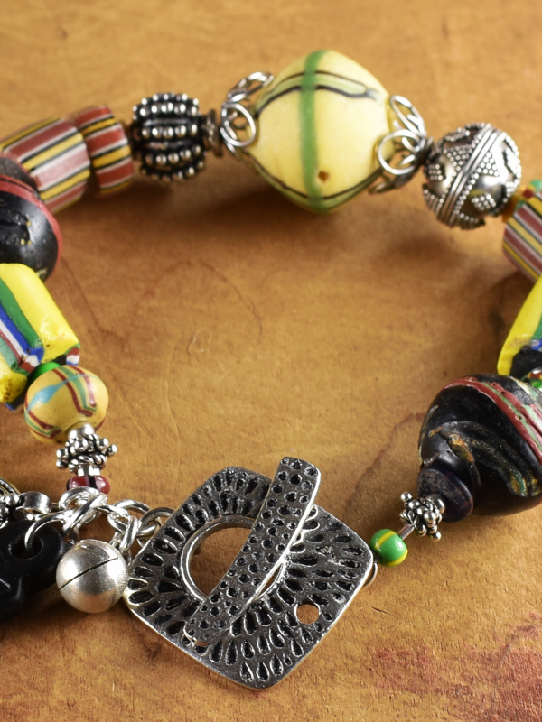 Lovely bright African beads with Sterling silver by Gloria Ewing.