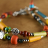 For summer or back to school, colorful 2 strand design by Gloria Ewing.