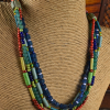 Ethnic blend of colorful beads in an original design by Gloria Ewing.