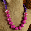 Pink and purple resin beaded necklace design for toddler girls by Gloria Ewing.